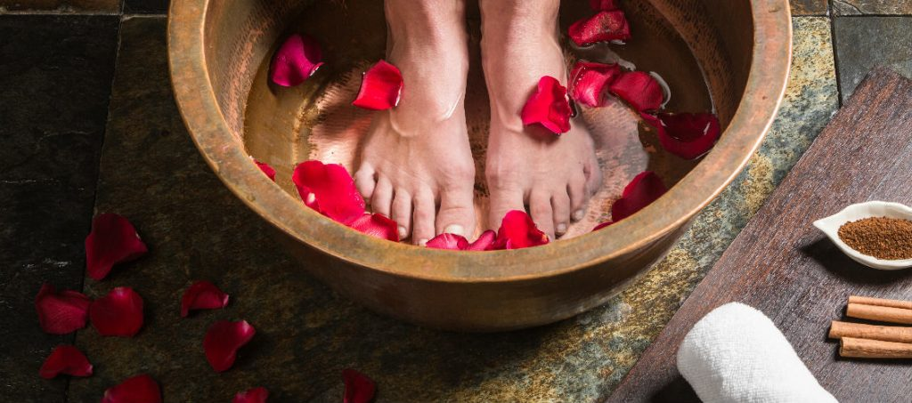 "Welcome ritual with ""feet and hands"" cleansing ritual using local herbs and or oils."