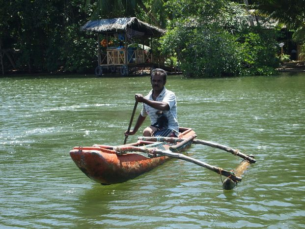 riding traditional boats in madu river